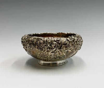 Lot 21 - A Chinese silver chrysanthemum decorated bowl,...