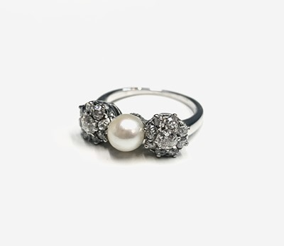 Lot 5 - An exquisite white gold ring set a central...