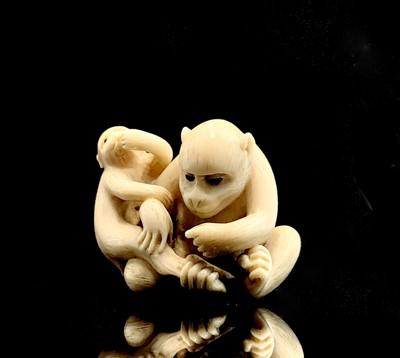 Lot 6 - A Japanese ivory netsuke of a monkey with her...