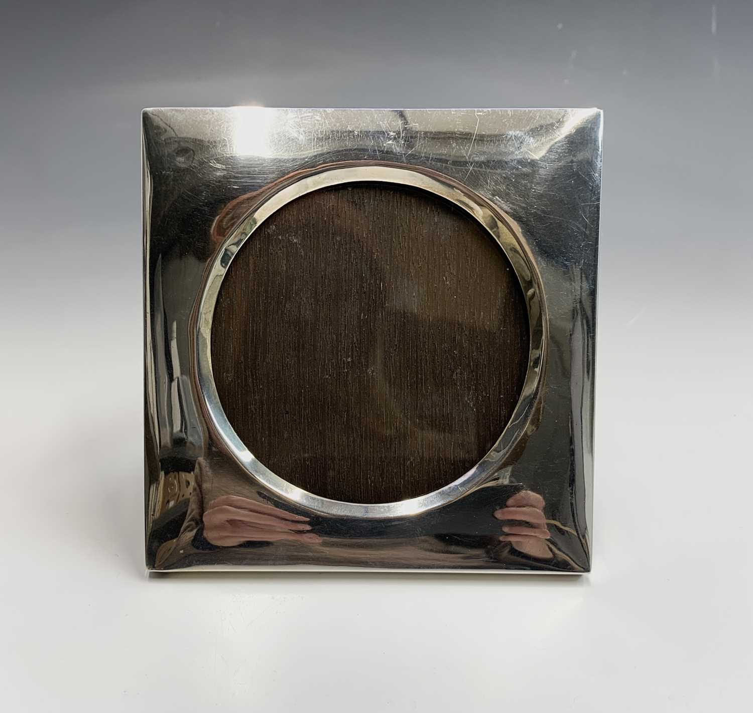 Lot 18-A square photo frame with wide silver border...