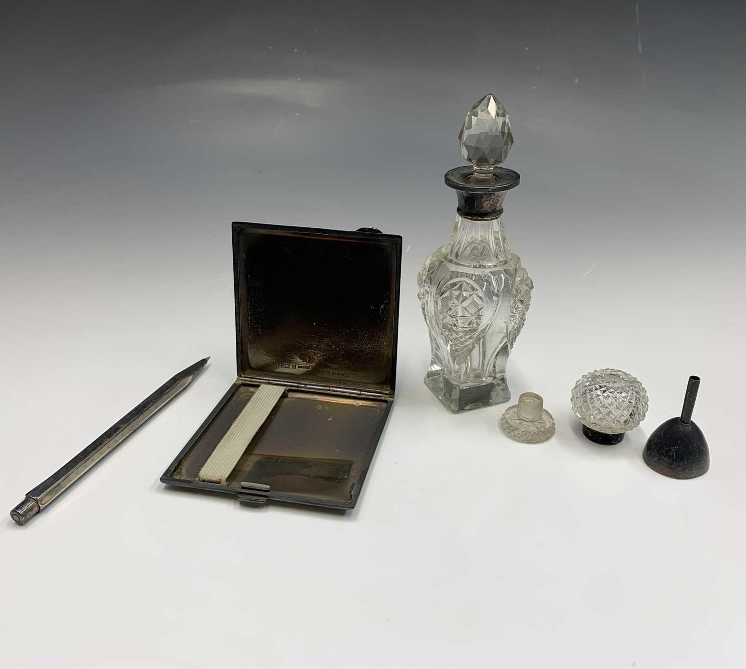 Lot 24-A silver cigarette case 3.70z together with...