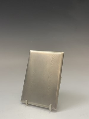 Lot 1083 - A heavy engine-turned silver cigarette case...