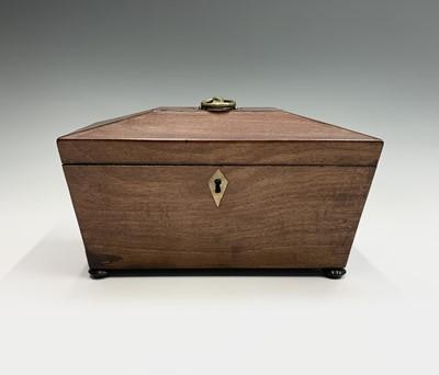 Lot 6 - A Regency mahogany tea caddy, the interior...