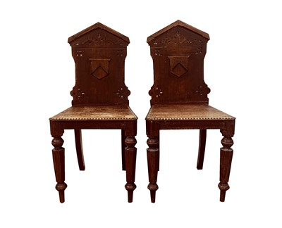 Lot 70 - A pair of oak hall chairs with Prideaux coat...