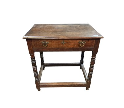 Lot 55 - An elm and oak side table, part 17th century,...