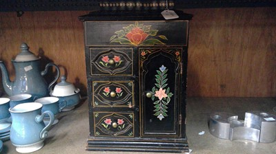Lot 14 - A black painted jewellery casket with floral...
