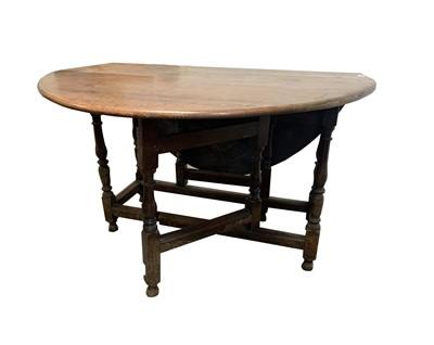 Lot 48 - An oak gateleg dining table, late 17th/early...