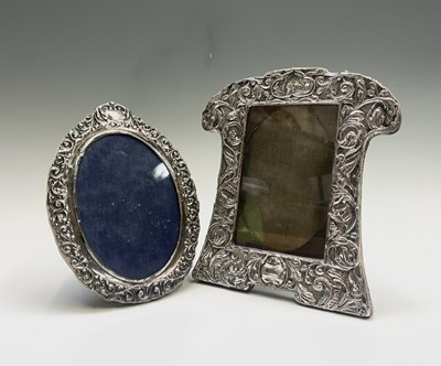 Lot 1027 - Two Edwardian silver mounted photograph frames