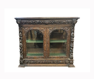 Lot 63 - A Victorian carved oak display cabinet, with...