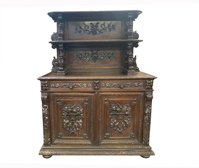 Lot 50 - A carved oak buffet, 19th century, the upper...