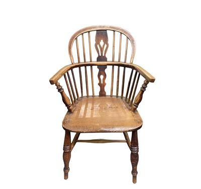 Lot 66 - An ash and elm Windsor armchair, circa 1860,...