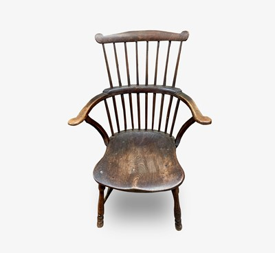 Lot 75 - An ash and elm 'comb back' Windsor armchair,...