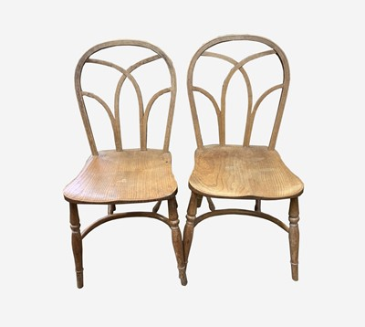Lot 81 - A pair of Gothic elm chairs, 19th century,...