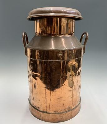 Lot 33 - A copper five gallon milk churn, the lid...