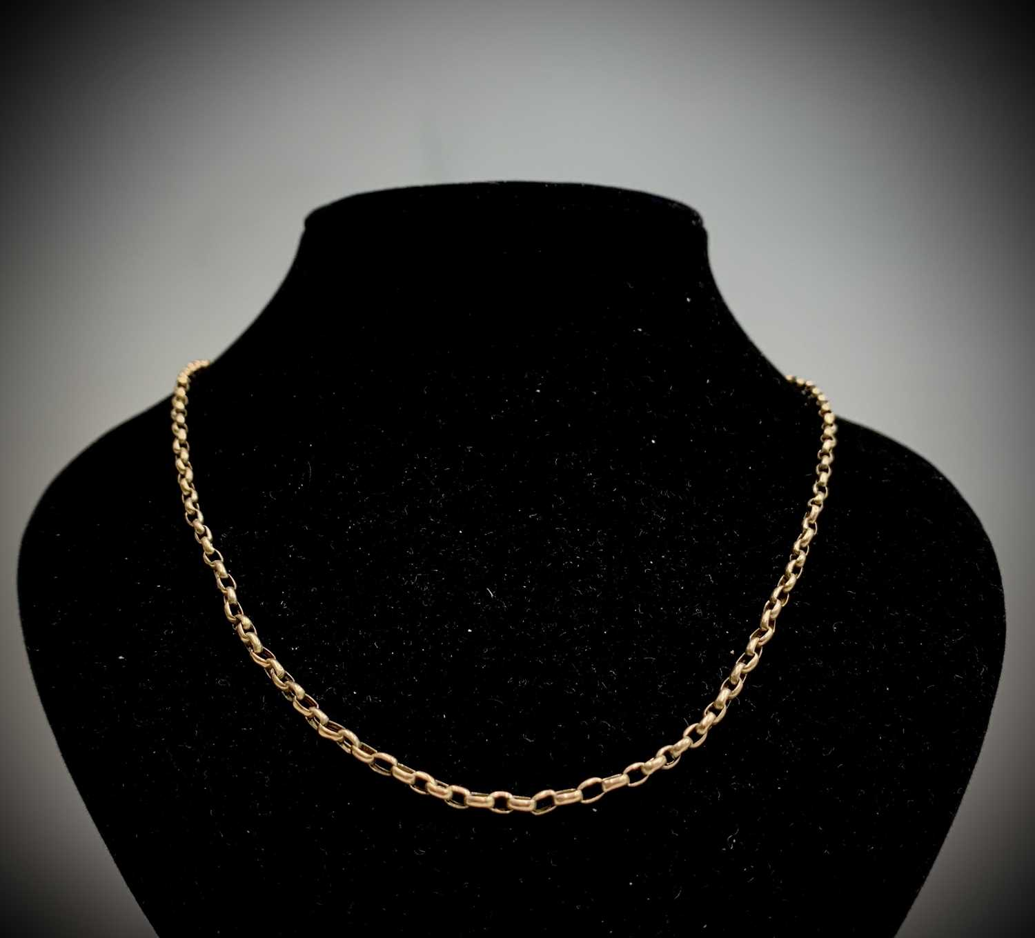Lot 22 - A 9ct gold bracelet with flat curb links...