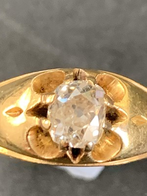 Lot 67 - An 18ct gold ring claw set with a bright oval...