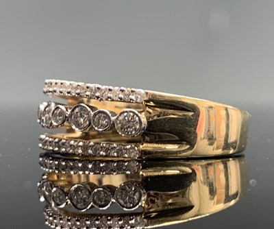 Lot 37 - A 14ct gold three row diamond ring 6.3gm
