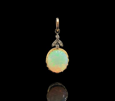 Lot 226 - An Edwardian gold-mounted opal pendant, it...