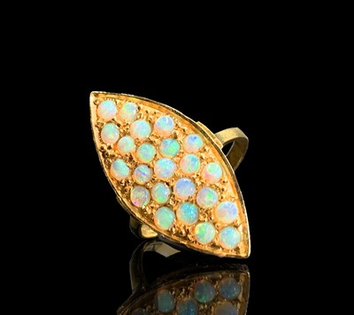 Lot 165 - An 18ct gold navette ring, pave set with opals...