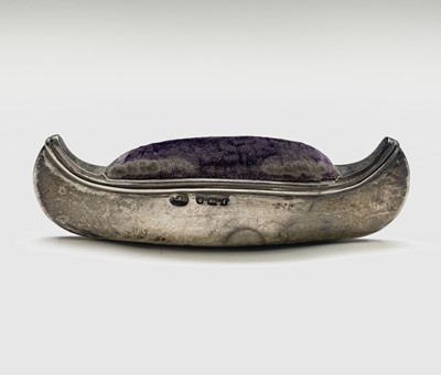 Lot 1011 - An Edwardian silver canoe pincushion by Levi &...