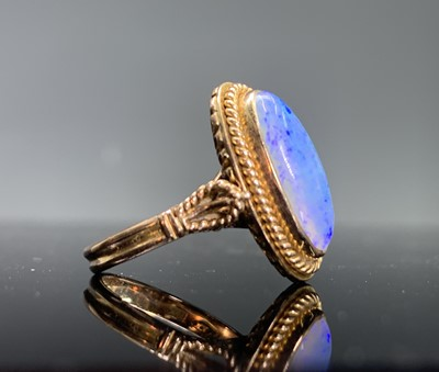 Lot 29 - A 14ct gold ring set with an opal in...