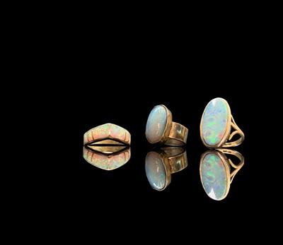Lot 199 - Three opal set silver rings 19.2gm