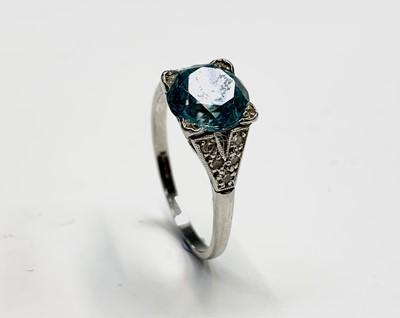Lot 150 - A platinum ring set an aquamarine of...