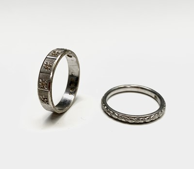 Lot 96 - A platinum band 3.8gm and an 18ct white gold...