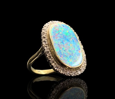 Lot 204 - An impressive 18ct (unmarked) gold oval opal...