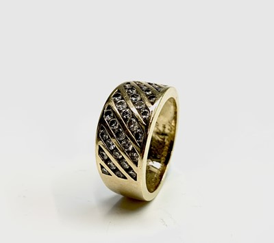 Lot 206 - An 18ct gold ring set with diagonal bands of...