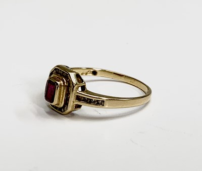 Lot 248 - An 18ct gold ruby and diamond square cluster...