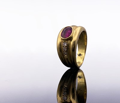 Lot 128 - An 18ct broad ruby-set ring with diamond line...