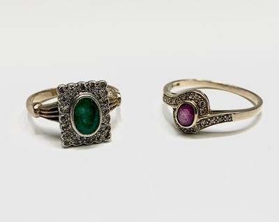 Lot 127 - Two 9ct gold ring, one set with an emerald and...