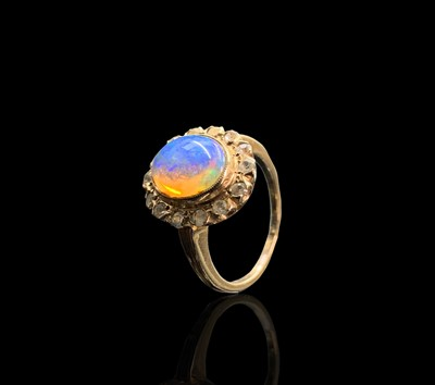 Lot 183 - An opal and white stone cluster 10ct gold ring...