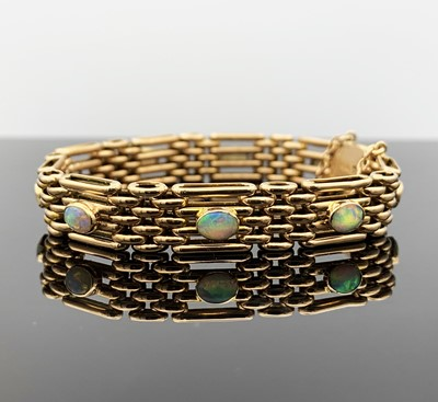 Lot 152 - A 9ct gold four-bar gate-link bracelet mounted...