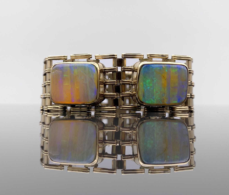 Lot 225 - A 9ct gold five-bar gate-link bracelet mounted...