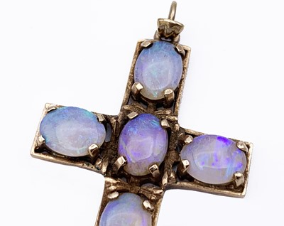 Lot 95 - A 9ct gold cross set with six opals 39mm 5.3gm