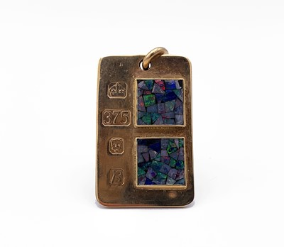 Lot 4 - A 9ct gold ingot pendant mounted with two opal...
