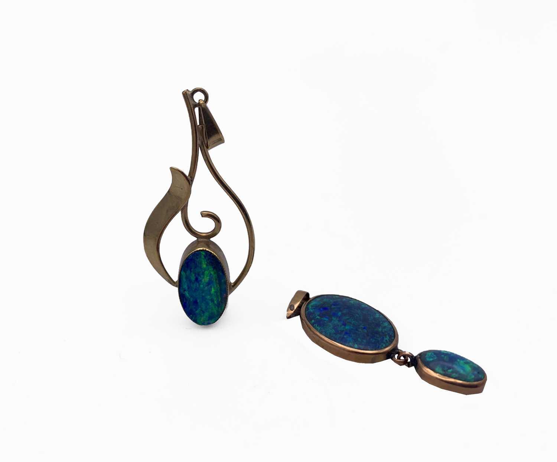 Lot 221 - Two gold-mounted opal pendants 3.6gm
