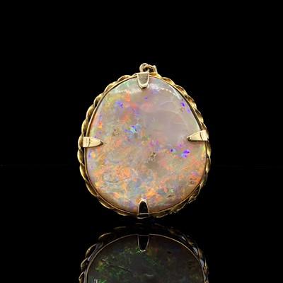 Lot 97 - A gold-mounted opal pendant/brooch 44mm 17.9gm