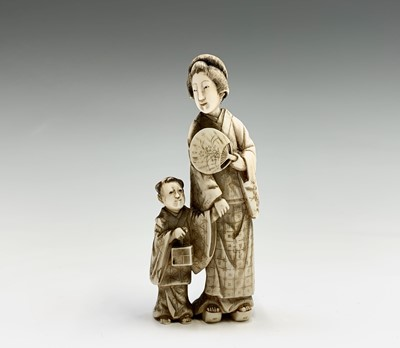 Lot 20 - A Chinese carved ivory group of a mother and...