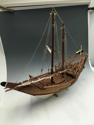 Lot 1 - A model sailing boat. Approx 96cm long and...