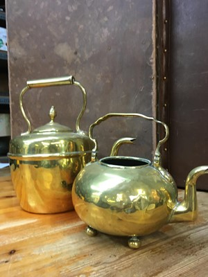 Lot 7 - A good size brass kettle, and another kettle...