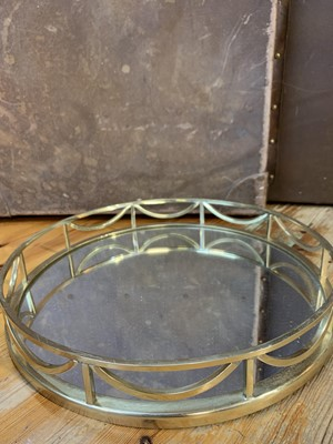 Lot 18 - A circular mirrored tea tray, a sequined...