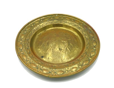 Lot 14-A brass alms dish, probably German late 17th/18th ...