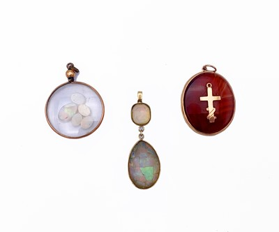 Lot 254 - Three gold-mounted pendants