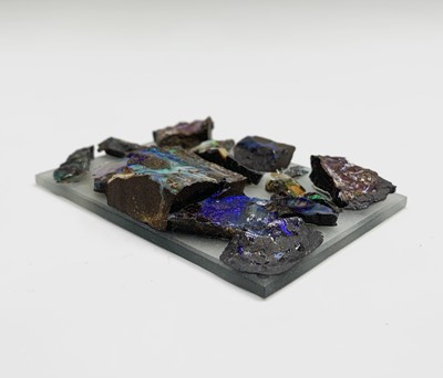 Lot 189 - Rough opals mounted on glass