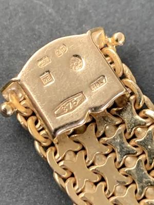 Lot 64 - A 9ct gold bracelet width 13.17mm 30.8gm
