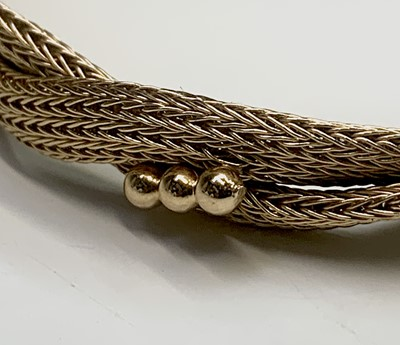 Lot 182 - An 18ct gold twin entwined mesh bracelet 15.9gm