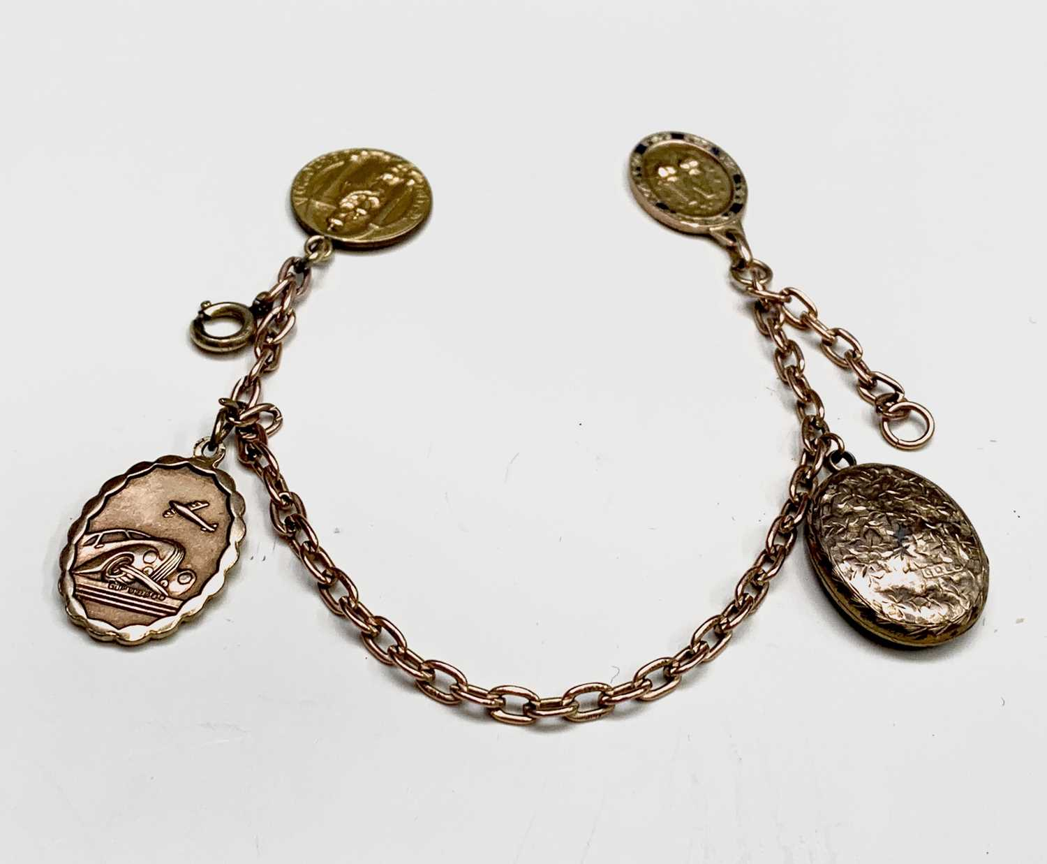 Lot 54 - A 9ct chain bracelet with three fobs (one gold?...